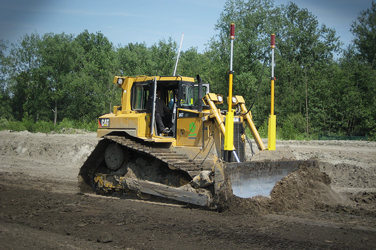 Catapillar dozer with 2D leveling system on road construction site