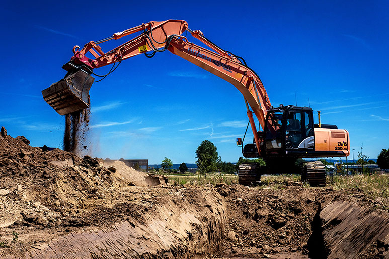 Hitachi excavator digs a trench in Germany