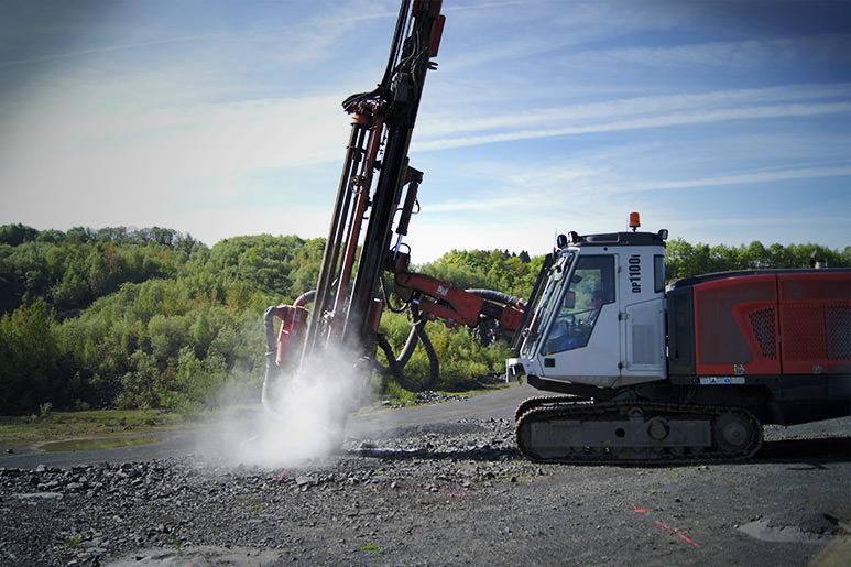 Sandvik DP1100 drill rig in action