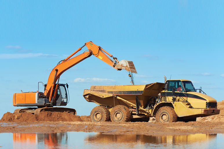 Hitachi Excavator dig sand at coast