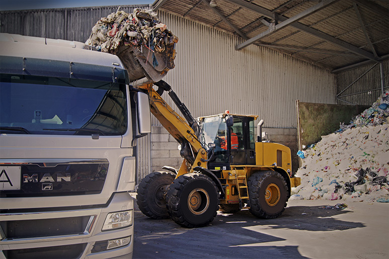wheel loader truck in landfill